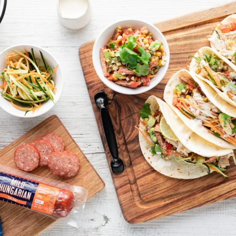 Tacos with DON® Mild Hungarian salami, chicken, corn & avocado salsa